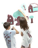Siblings working on the picture. Royalty Free Stock Images