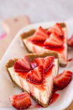 Sices of Fresh Cheesecake Dessert With Cut Up Strawberries Stock Image