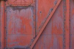 Sich fortbewegendes Detail, rote Wand stockbild