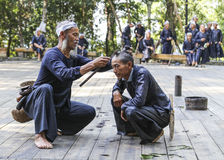 Sichelhaarschnitt in basha miao Dorf, guinzhou, Porzellan Lizenzfreie Stockfotografie