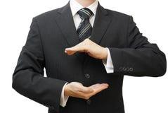 Sichere Geschäftskonzept-Geschäftsmannhände im Schutz formen Lizenzfreie Stockfotos