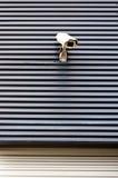 Sicherheit cctv-Kamera auf einer Wand des Handelsbaus Stockfoto
