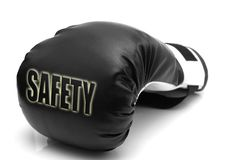 Sicherheit - ein Verpackenhandschuh stockfotografie