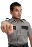 Sicherheits- oder Gefängnisoffizier, der Finger zeigt Stockfoto