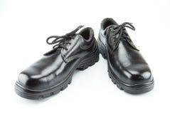 Sicherheits-Stiefel auf weißem Hintergrund Stockfotos
