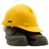 Sicherheits-Sturzhelm und Sicherheits-Schuhe stockfotos
