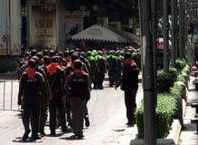 Sicherheitskräfte auf dem Marsch Lizenzfreie Stockfotografie