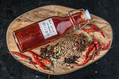 Sichuan chili oil with spices royalty free stock photo