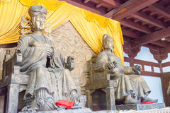 SICHUAN, CHINA - Mar 29 2015: Statues of Empress Wu Zetian and E. Mperor Gaozong at Huangze Temple. a famous historic site in Guangyuan, Sichuan, China royalty free stock images
