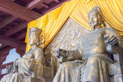 SICHUAN, CHINA - Mar 29 2015: Statues of Empress Wu Zetian and E. Mperor Gaozong at Huangze Temple. a famous historic site in Guangyuan, Sichuan, China royalty free stock photo