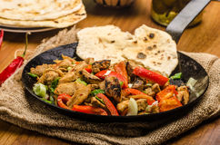Sichuan meat mix with naan. Sichuan meat mix with vegetables and homemade naan bread royalty free stock image