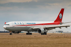 Sichuan. PRAGUE, CZECH REPUBLIC - MARCH10: Airbus A330-300 of Sichuan Airlines after landing at PRG Airport in Prague on March 10, 2017. ichuan Airlines is a Stock Images