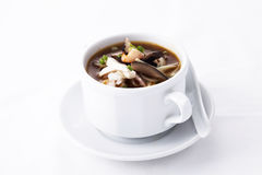 Sichuan sour soup serve in white bowl. On background stock image