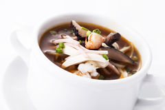 Sichuan sour soup serve in white bowl. Close up stock images