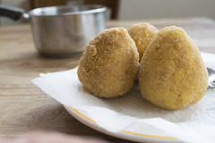 Sicilian arancine fried in boiling oil Stock Photography