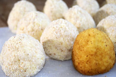 Sicilian arancini. Raw arancini a rice croquette stuffed with a sauce of minced meat, tomato, and peas Stock Image