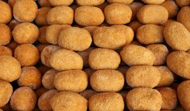 Sicilian Arancini, stuffed rice balls coated with bread crumbs and then deep fried, on a shelf of a local market.  Royalty Free Stock Image