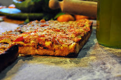 Sicilian bakery. Traditional sfincione tomato pizza. Traditional Sicilian savoury bakery - sfincione. An Italian regional pizza variation with tomato and oregano stock photography