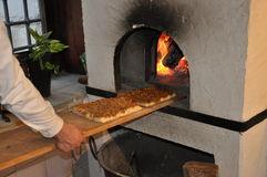 Sicilian bakery. Traditional sfincione tomato pizza Stock Photos