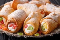 Sicilian baking cannoli with cheese cream and candied fruits mac Royalty Free Stock Photo