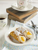 Sicilian cannoli with orange. Royalty Free Stock Photography