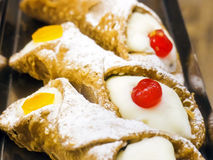 Sicilian cannolo. Three cannoli filled with white sweet ricotta. Taken up close. typical Sicilian sweet, but famous and spread throughout Italy and the world stock photo