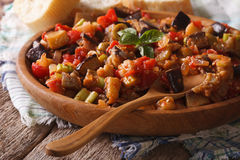 Sicilian Caponata with aubergines closeup on wooden plate. horiz Royalty Free Stock Photo