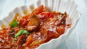 Sicilian Caponata. Caponata - Sicilian eggplant dish consisting of a cooked vegetable salad made from chopped fried eggplant and celery seasoned with sweetened stock photos