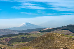 Sicilian countryside. Countryside landscape around Ragusa with the Volcano Etna at horizon and Chiaramonte Gulfi on the right Stock Photo