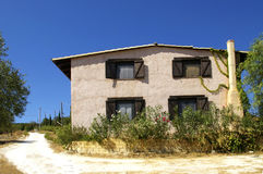 Sicilian farm house. Traditional Sicilian farm house surrounded trees stock photography