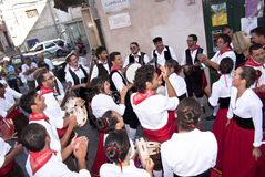 Sicilian folk group from Polizzi Generosa. POLIZZI GENEROSA, SICILY - AUGUST 21: Sicilian folk group from Polizzi G. at the International Festival of hazelnuts royalty free stock photos