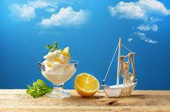 Sicilian lemon sorbet with blue sky in the background. Closeup royalty free stock photo