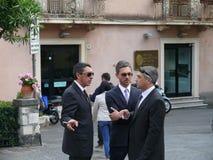 Sicilian mafia. Three men are discussing the deal at Taormina's square Stock Photo