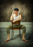 Sicilian man in traditional costume sitting Stock Photo