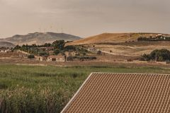 Sicilian Panorama. Wirh hills, houses and field shoot during summer at sunset royalty free stock images