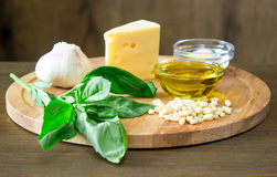 Sicilian pesto ingredients on wooden table. Sicilian basil pesto ingredients on wooden table Stock Image