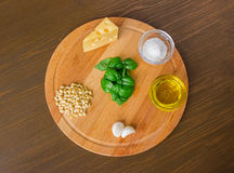 Sicilian pesto ingredients on wooden table. Sicilian basil pesto ingredients on wooden table. front Royalty Free Stock Photo