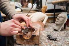 Sicilian puppet artisan at work Stock Images