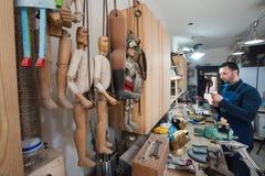 Sicilian puppet artisan at work Royalty Free Stock Photos