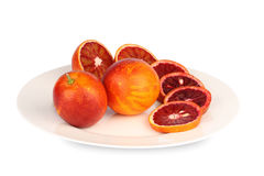 Sicilian red oranges on plate Stock Photography