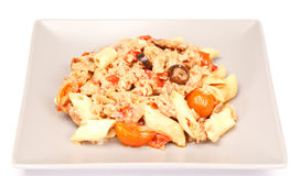 Sicilian Salad. Mixed sicilian salad with macaroni pasta, red peppers, cherry tomatoes, black olives and tuna. Served in a grey plate. Typical from Italy. On Stock Images