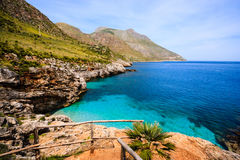Sicilian shore. Blue water bay in Zingaro Natural Reserve, Sicily, Italy Royalty Free Stock Images
