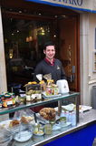 Sicilian smiling guy selling sweets and pastries Stock Image