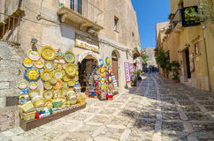 Sicilian souvenirs. Ancient, typical narrow and cobblestone street in Erice, Sicily, Italy. Stock Images