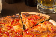 Sicilian style pizza with beer Royalty Free Stock Photo
