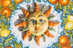 Sicilian sun face of ceramic in Taormina, Italy. Sun face of ceramic in Taormina at Sicily, Italy Stock Images