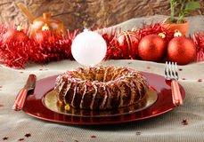 Sicilian sweet with dried figs and pastry on the Christmas table. On complex background Royalty Free Stock Photos