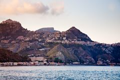 Sicilian town Taormina on sunset Royalty Free Stock Photo