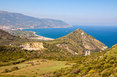 Sicilian view. Sicilian mountains, sea, road and tunnel Stock Image