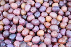 Sicilian violet olives at the marketplace Stock Photos
